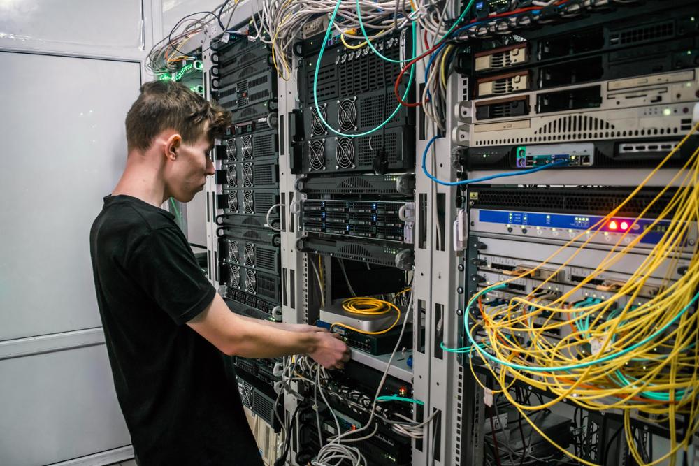 technician-rewiring-cables